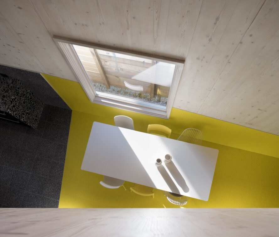 aerial view of dining table on yellow floor