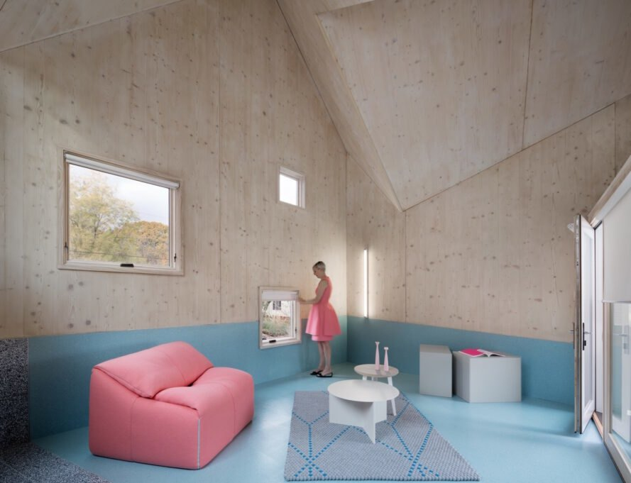 wood-lined interior with blue floors and pink sofa