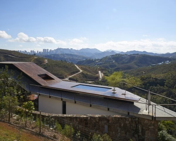 home on a slope with rooftop pool