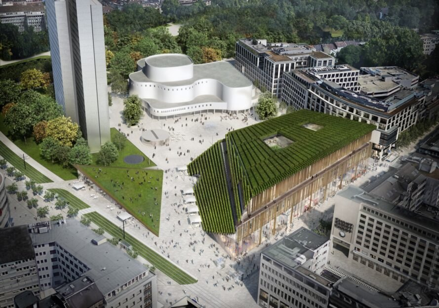 aerial view of trapezoid-shaped building with sloping green roof during the day