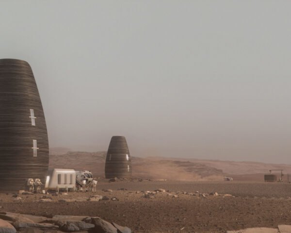 series of vertical round pod-like structures on desolate landscape