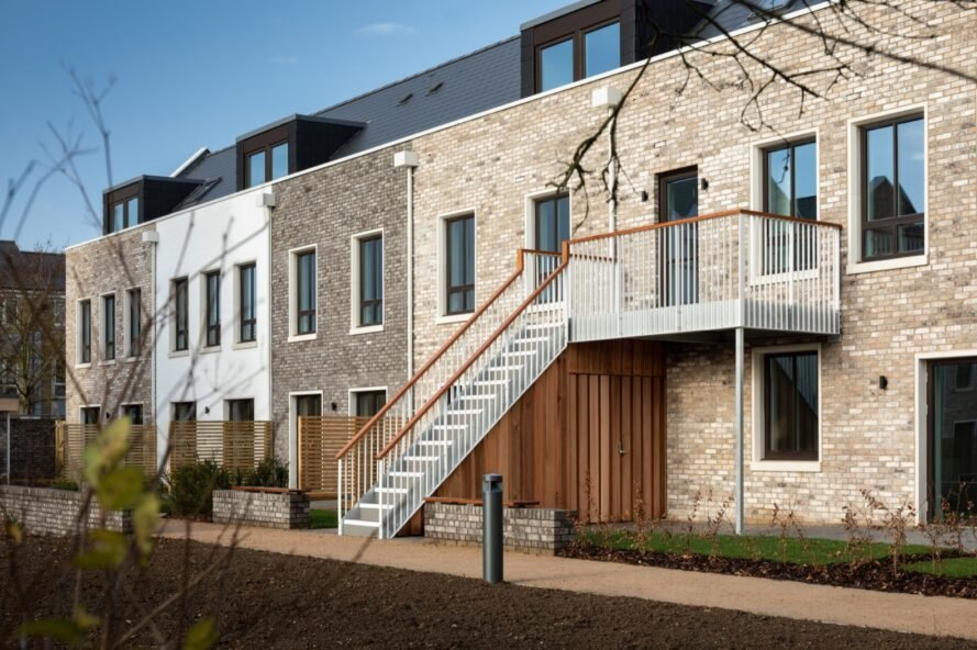an outdoor staircase connected to a balcony on the exterior of the cohousing units