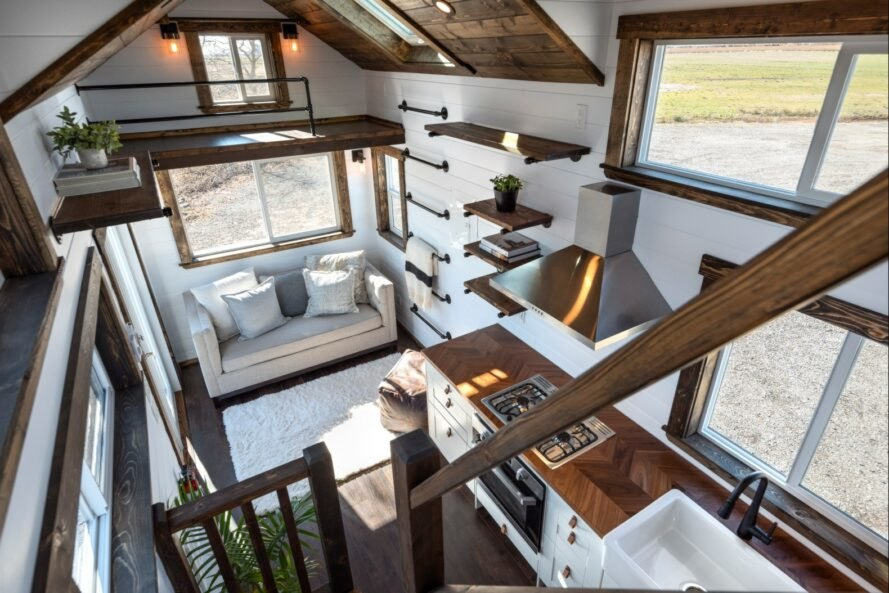 aerial shot of tiny home interior with white walls and dark wood accents