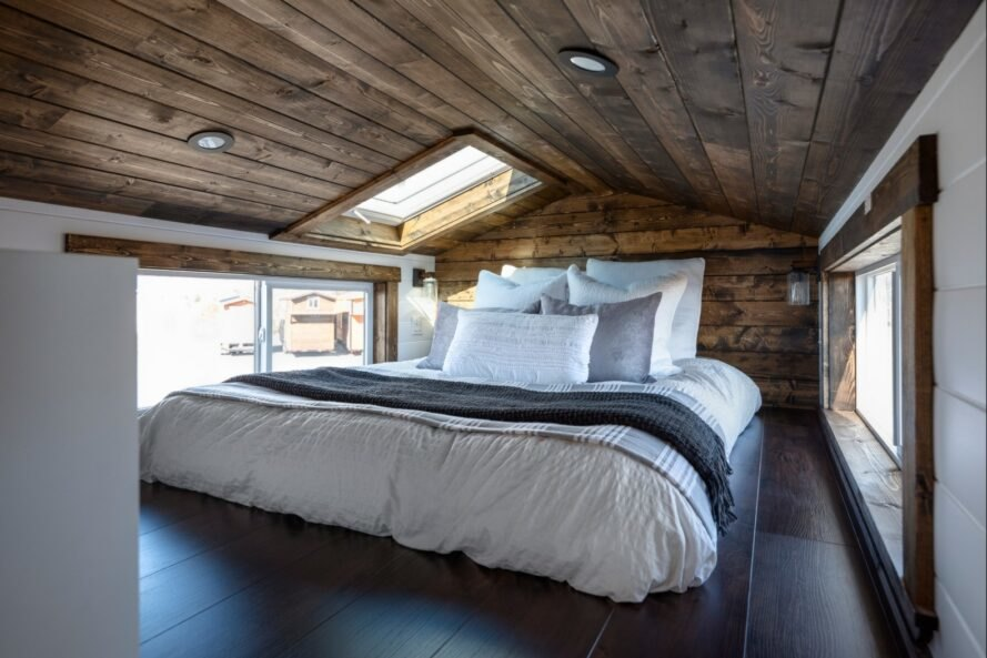 tiny home bedroom with large bed and wood ceiling