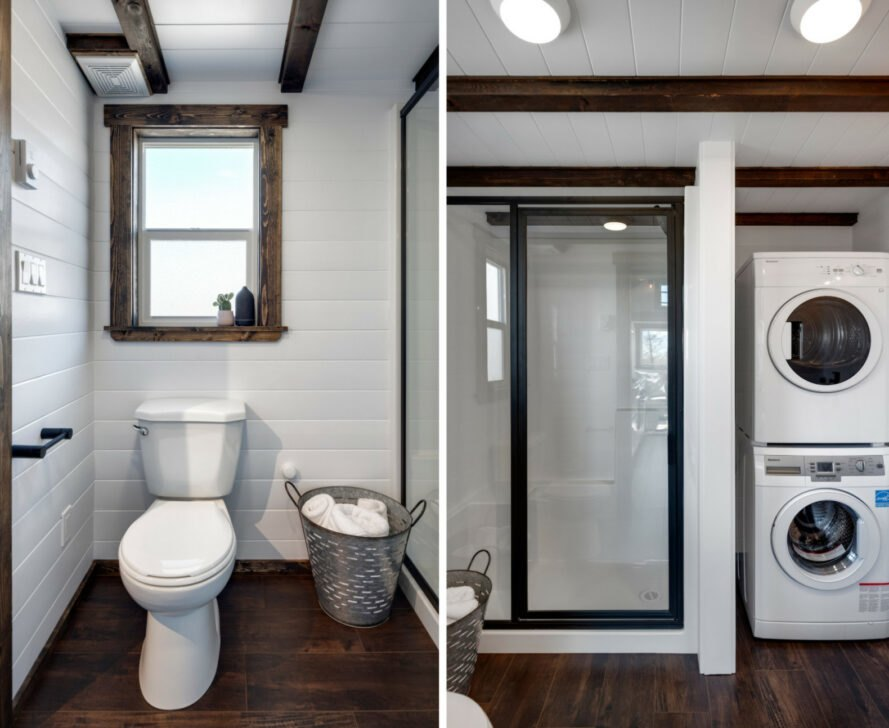white bathroom with composting toilet, glass standing shower and a tiny washer and dryer stacked on top one another