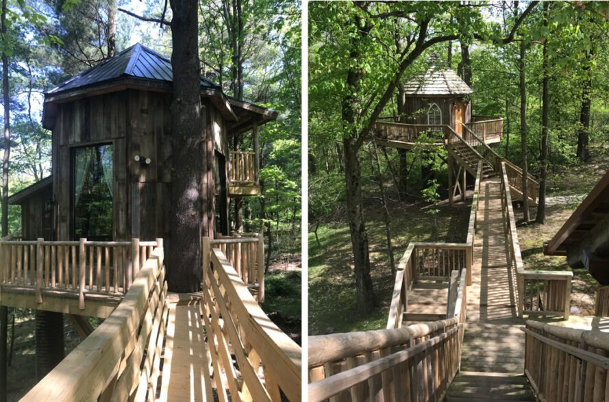a small treehouse with wood bridges in Ohio is surrounded by greenery and trees