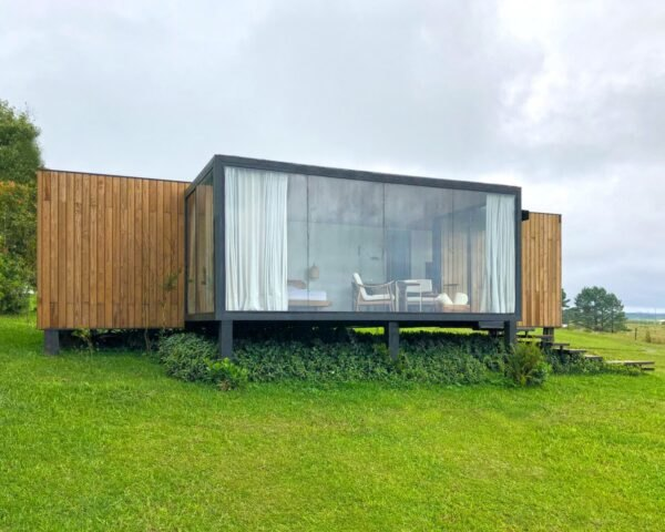 elevated prefabricated metal container with large glass widow