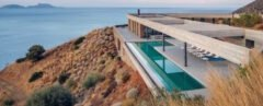 modern home overlooks ocean views on side of cliff