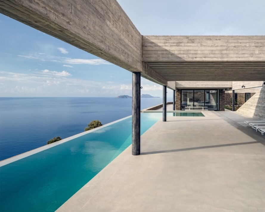 pool alongside of the home with uninterrupted views of the ocean