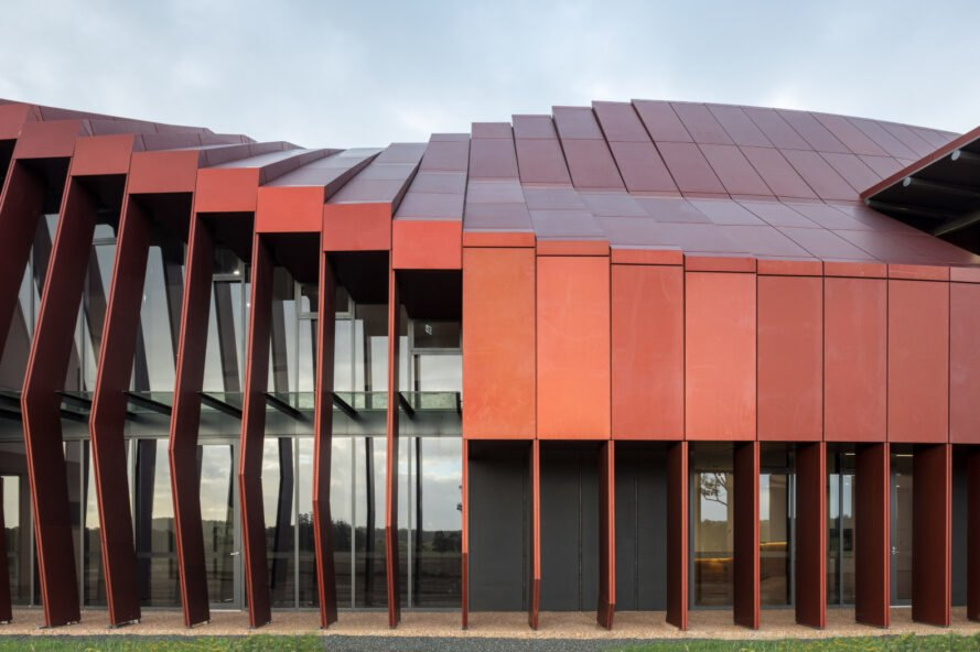 long building with red metal cladding