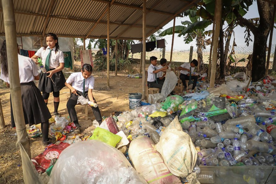 students sorting plastics for recycling
