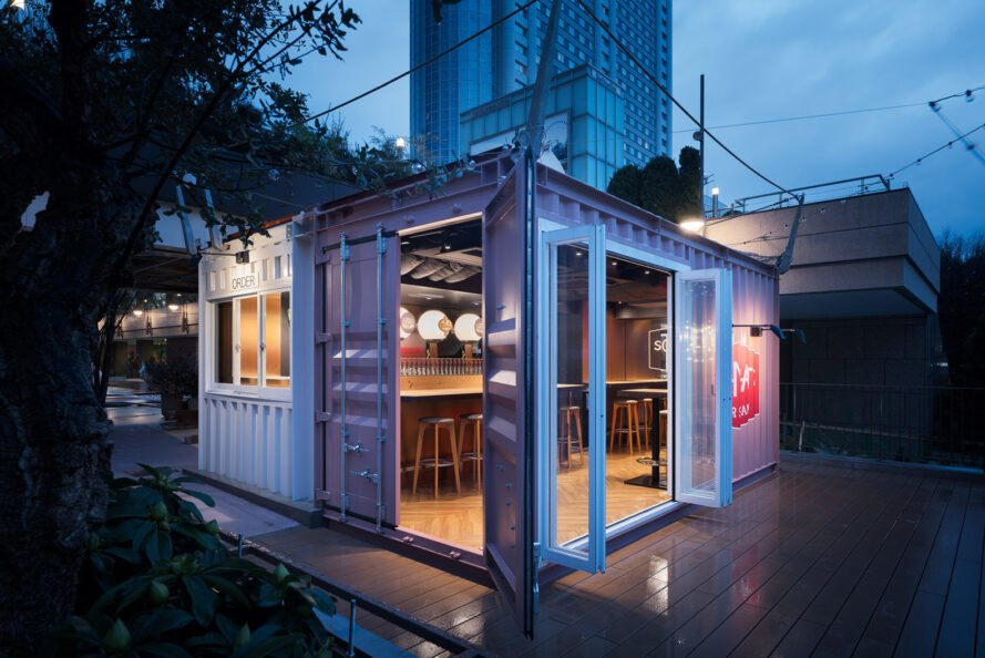 small gray shipping container with doors and windows open