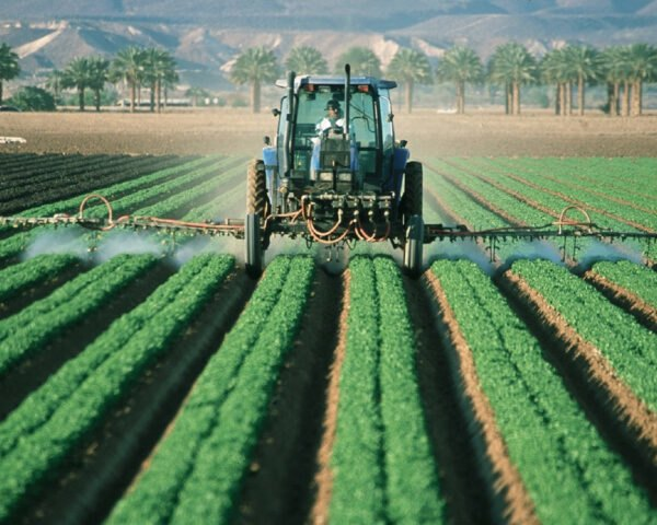 farmer sprays pesticide on agricultural fields