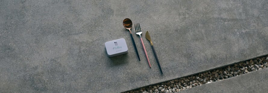 reusable cutlery beside small white box
