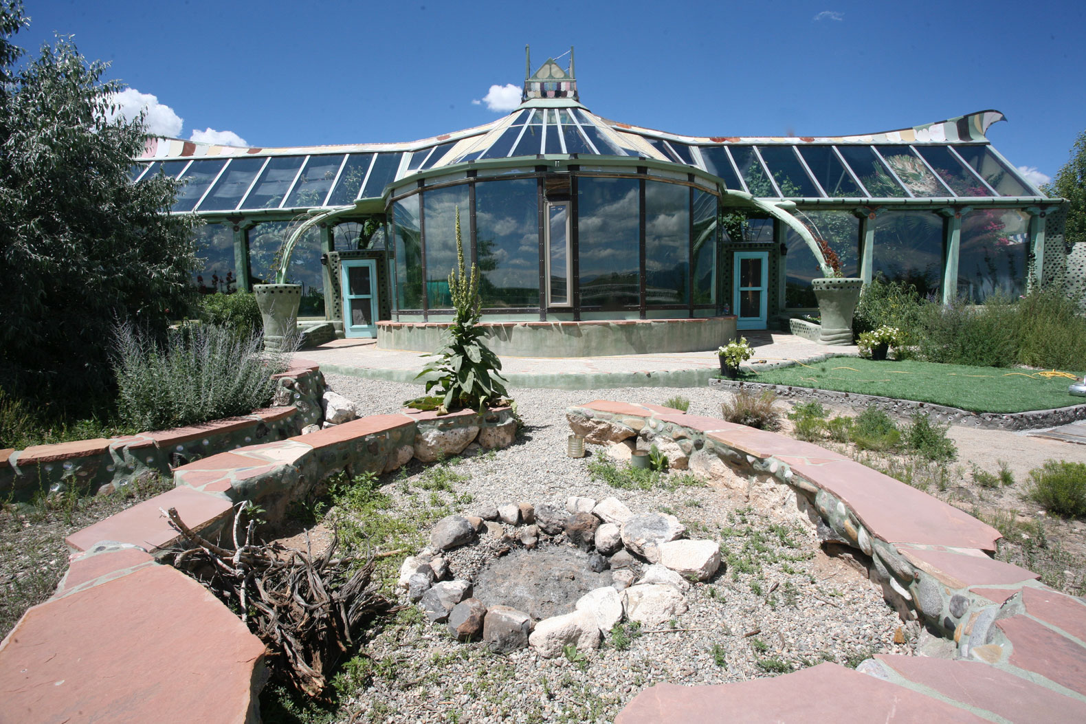 Phoenix Earthship features a food garden and jungle in off-grid fashion