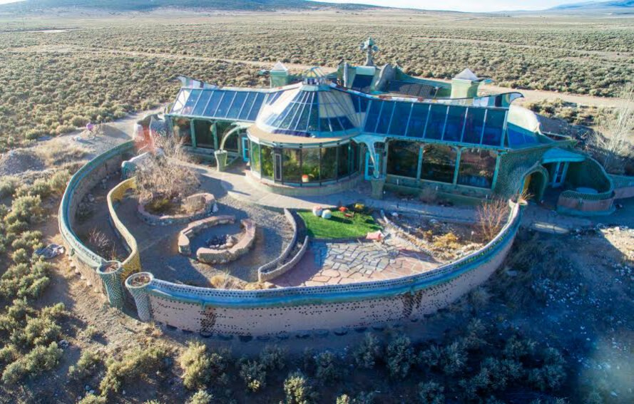 aerial view of earthship lodging made from recycled and natural materials