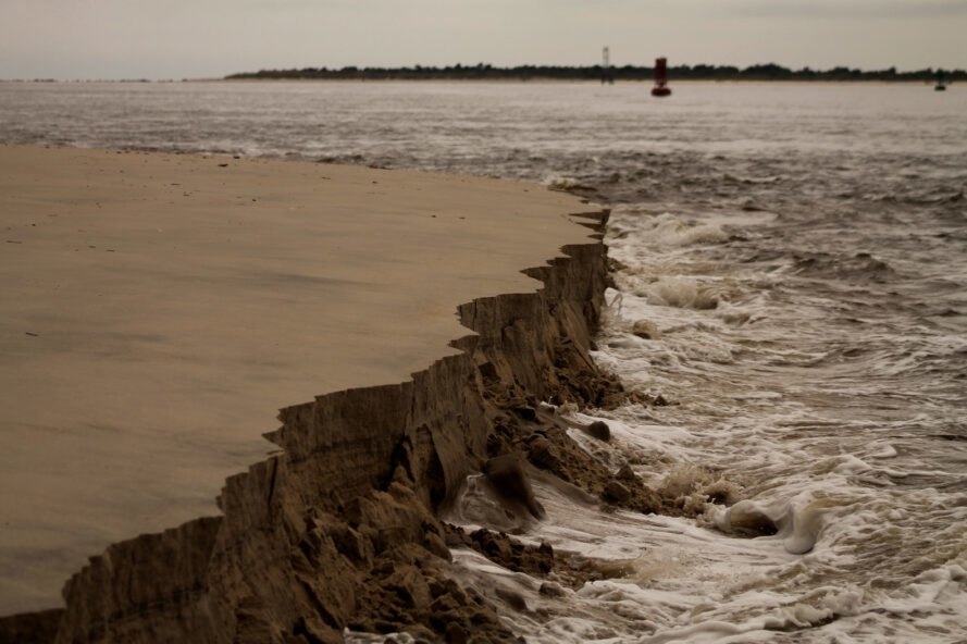 coastal erosion shows how large pieces of sand are disappearing