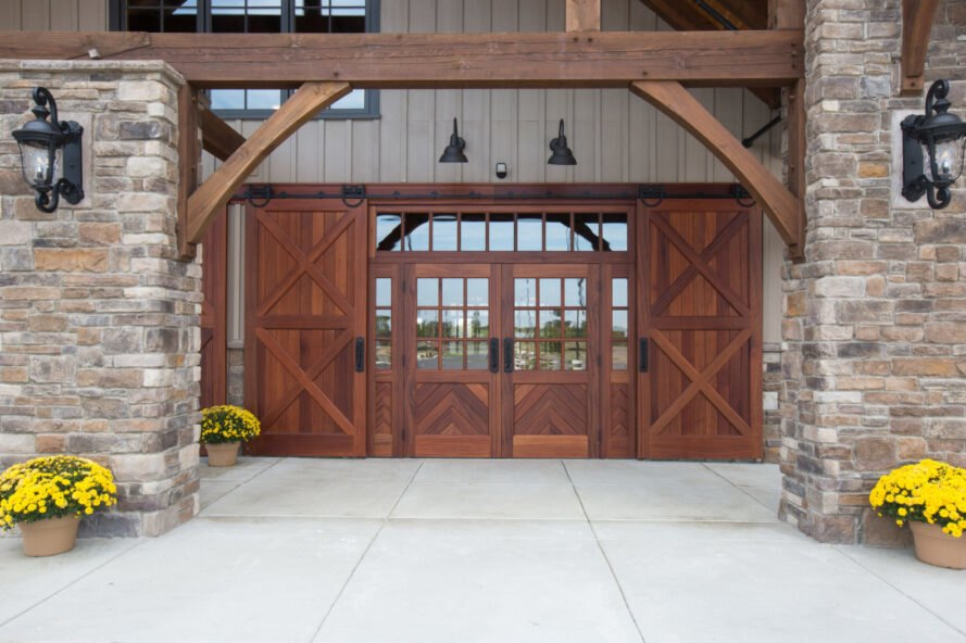 entryway with large wooden doors