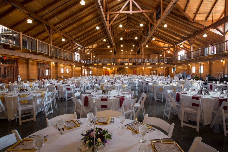 large dining hall with exposed timber beams in the ceiling