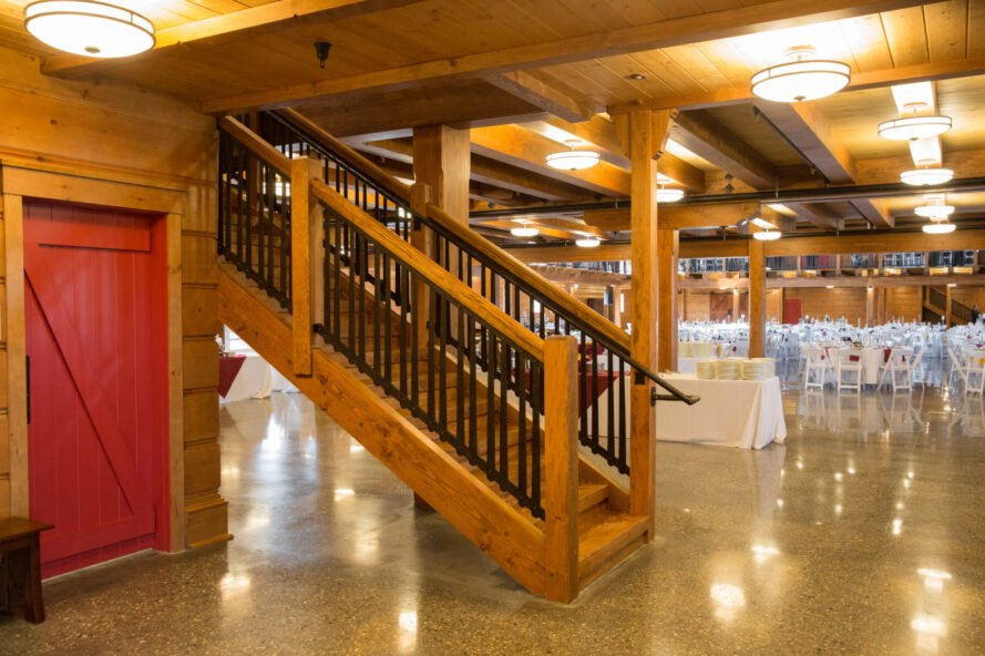 wooden staircase in large dining hall