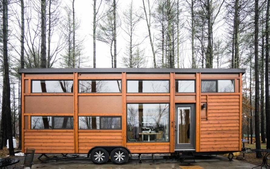 two-story tiny home with lots of windows