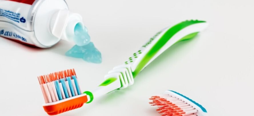 colorful toothbrush and blue toothpaste
