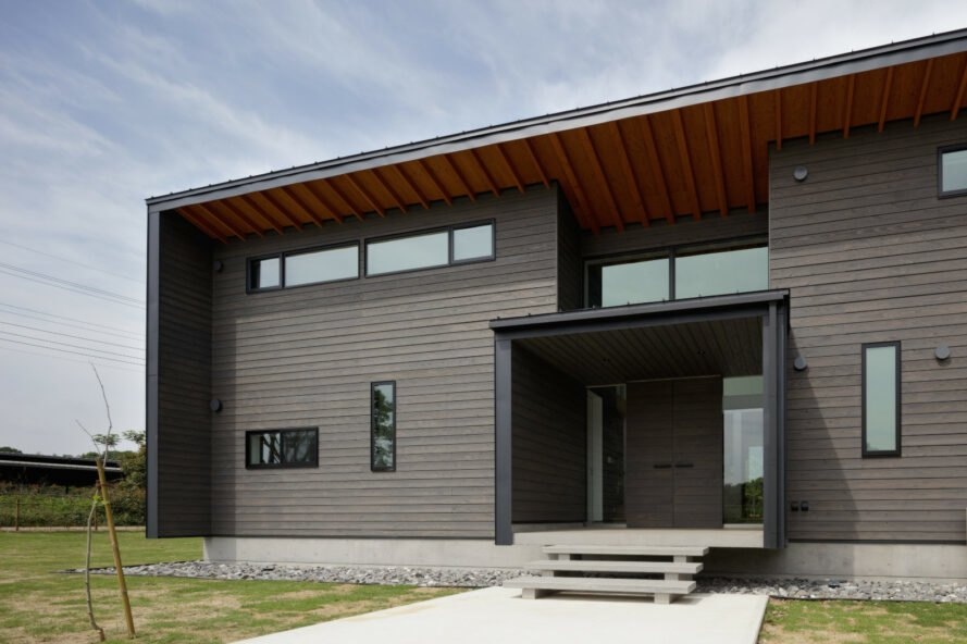 black timber building with a boxed entranceway