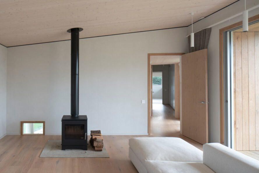 minimalist living room with sofa and black chimney