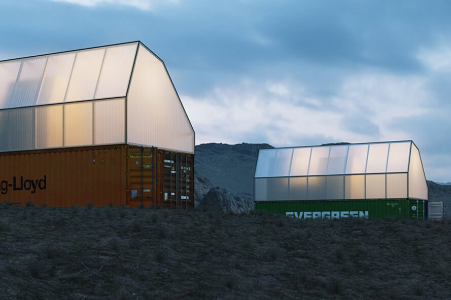 cargotecture modular home on a grassy hill