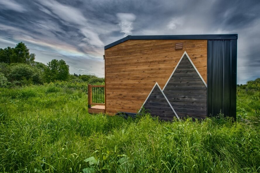 tiny wooden home with triangular design on the cladding