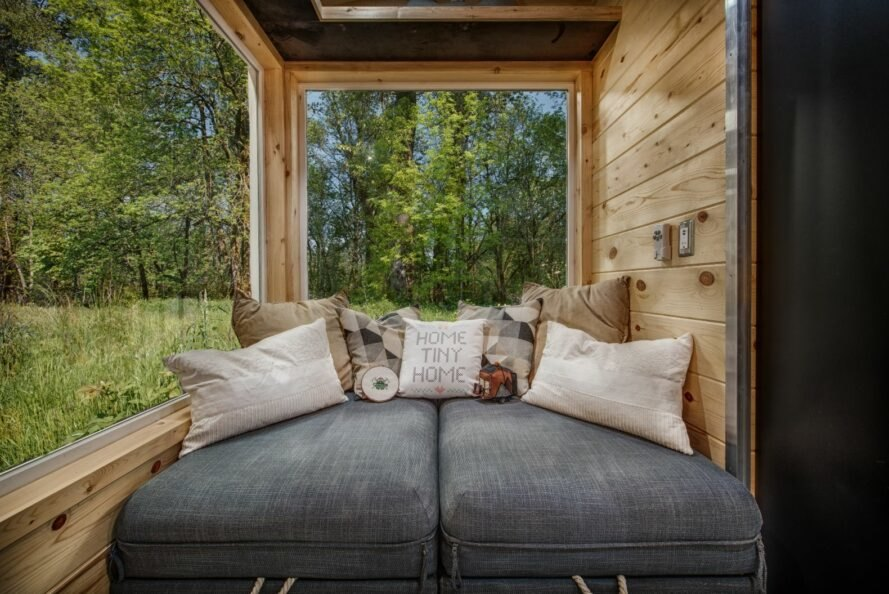 gray loveseat in tiny home living space
