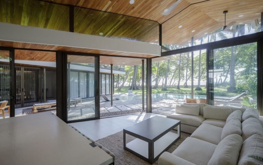 living area with wood ceilings and glass walls