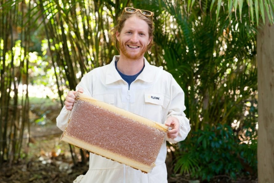 man holding beehive brood frames