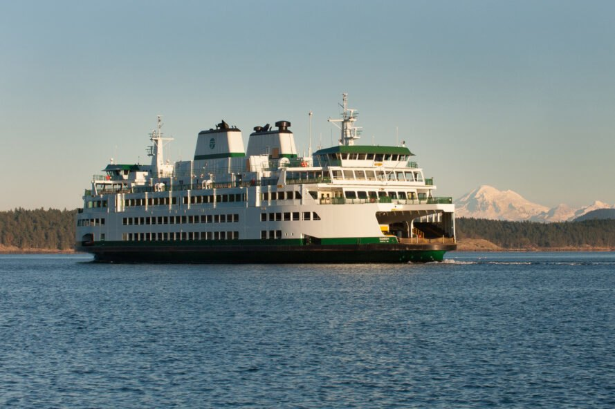 a ferry surrounded by green hills in Washington