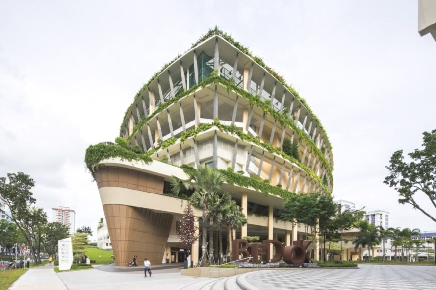 three-story triangular building with greenery on each floor