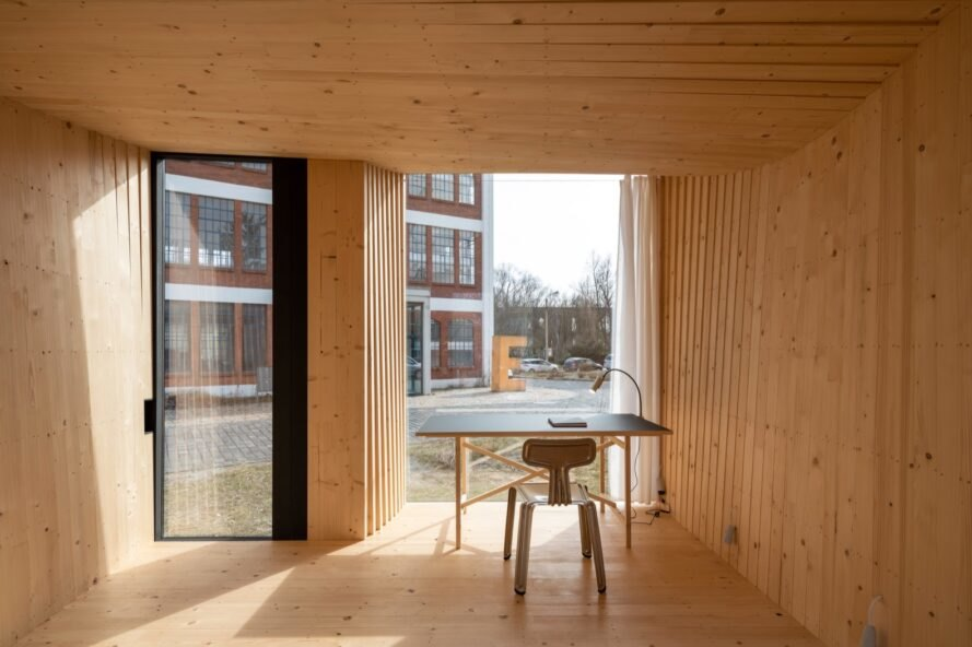 interior of wooden timber prototype home with wood floors and walls