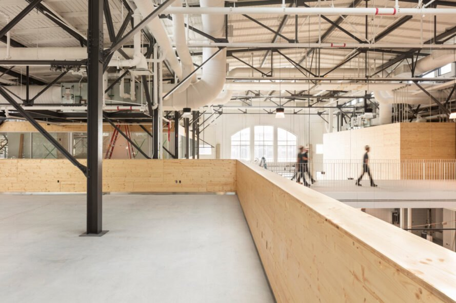 indoor market with concrete floors and wooden partition