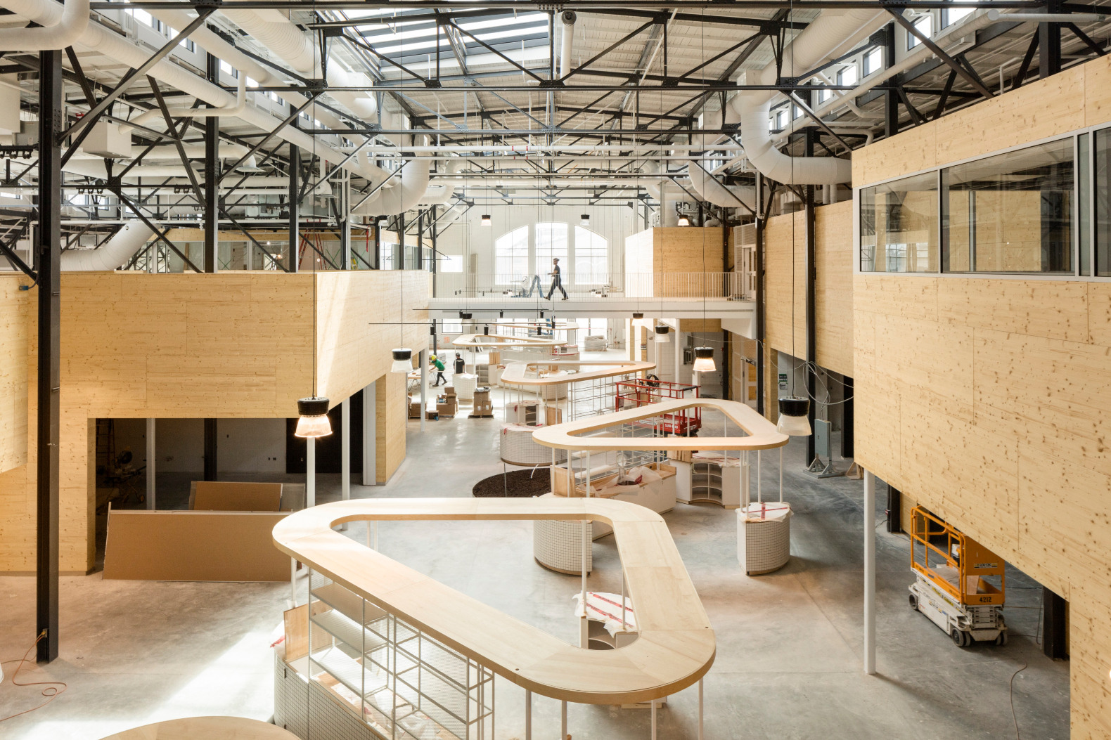 A 1923 building in Quebec is now a light-filled public market complete with aquaponics systems