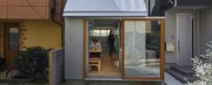 tiny home between two buildings with large glass door opened