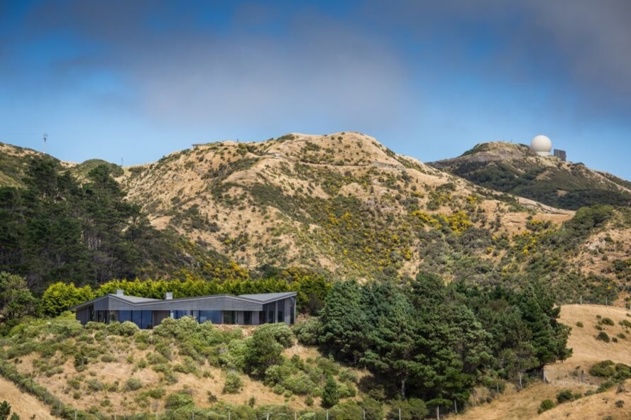 gray home secluded on a hill