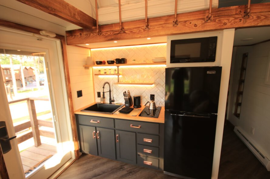 tiny home kitchen with full-sized refrigerator