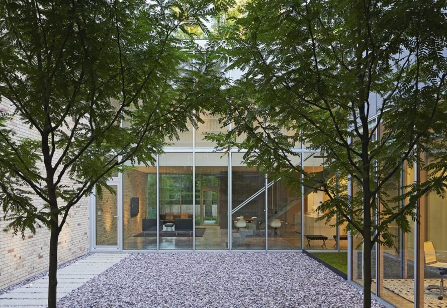 courtyard outside home with glass walls