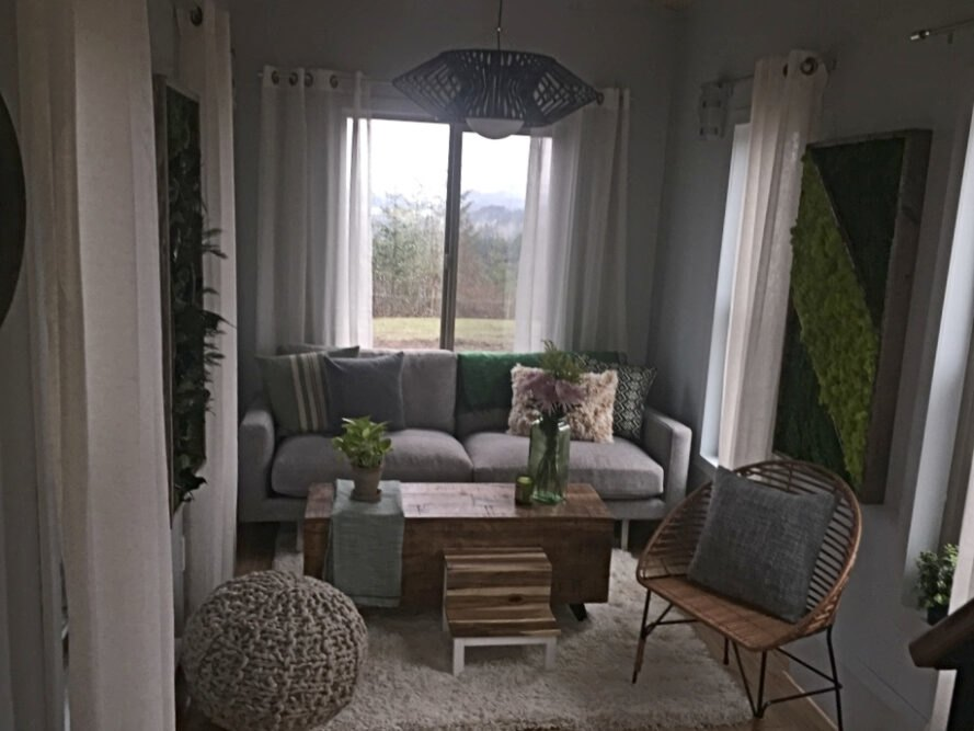 living space with gray sofa