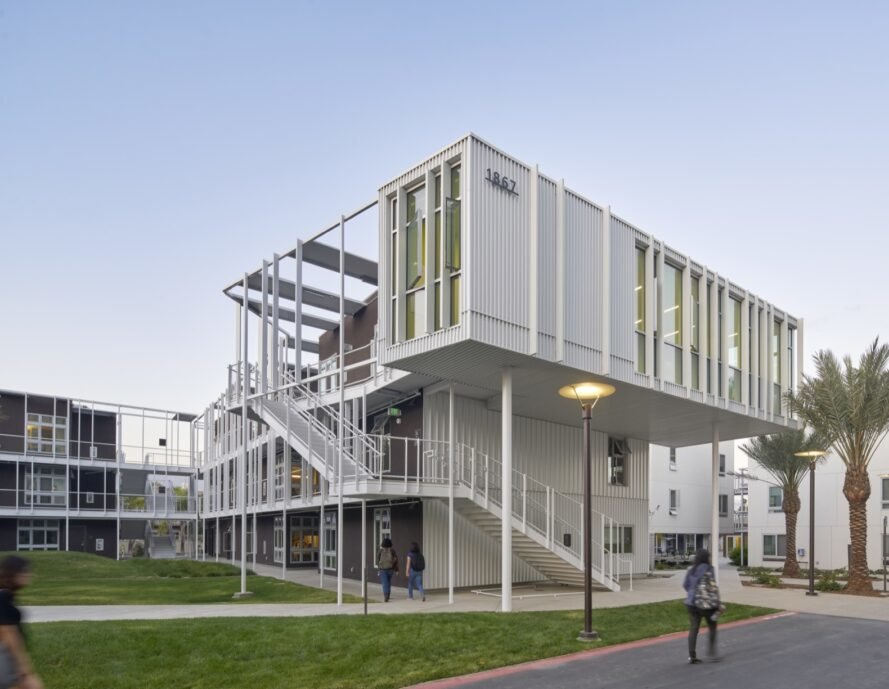 metal panel structure for student housing adorned with nearby trees and grass