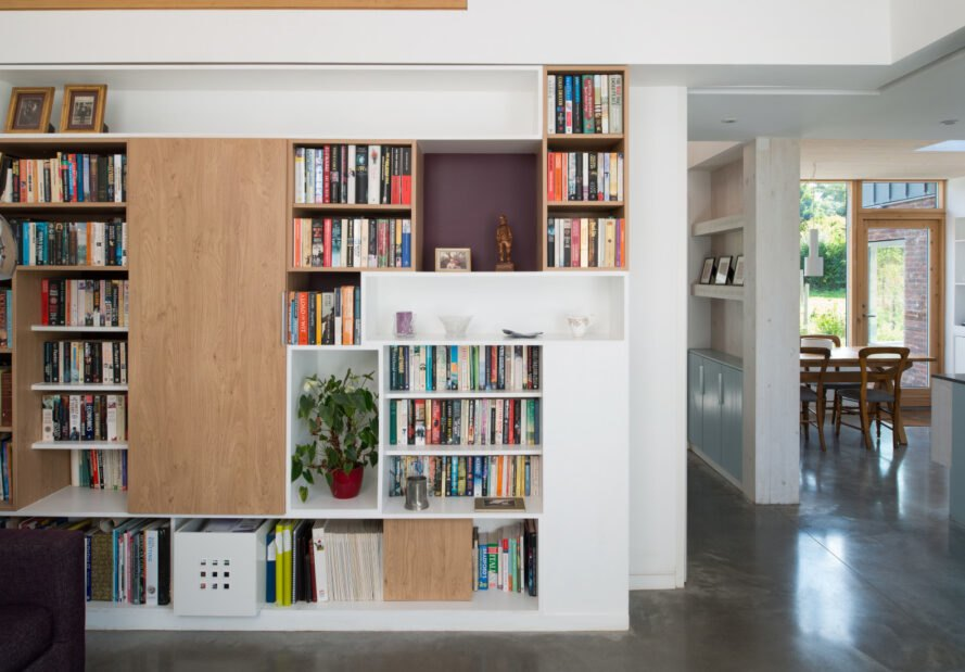 a wall lined with bookshelves