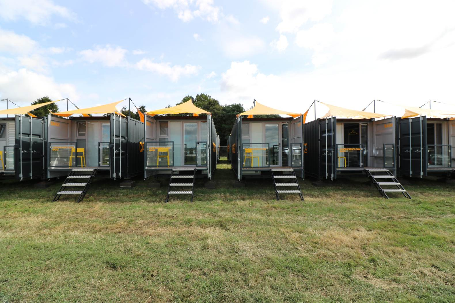 Pop-up shipping container accommodations add a bit of luxury to local festivals