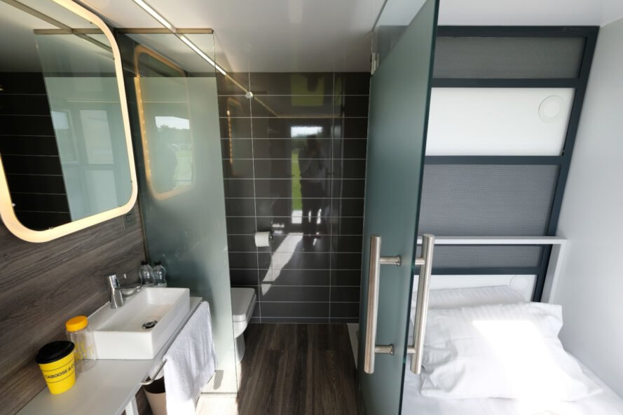 small gray bathroom inside a shipping container
