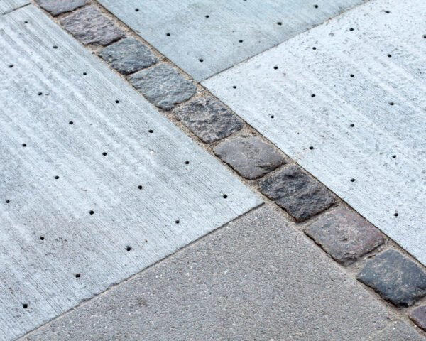 sidewalk tiles with tiny holes for absorbing water
