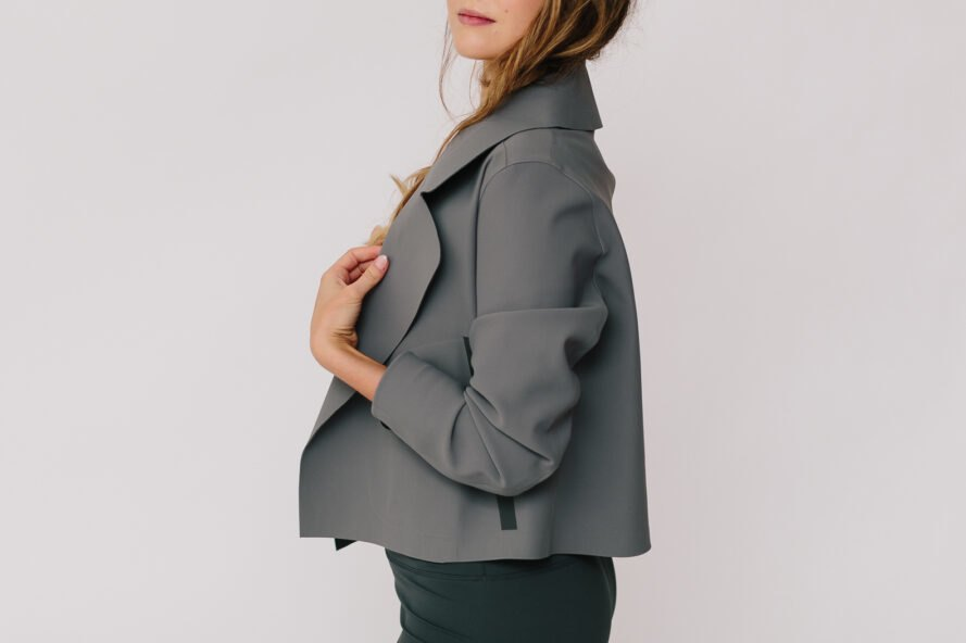 model wearing gray blazer