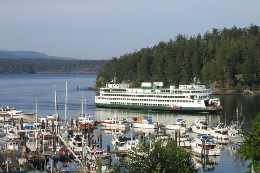 a ferry surrounded by green hills in Washington near dock